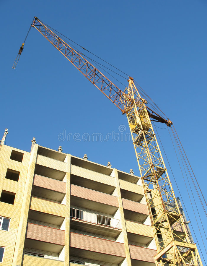 Building crane - 8. Building cranes on construction vein high-rise building royalty free stock photography