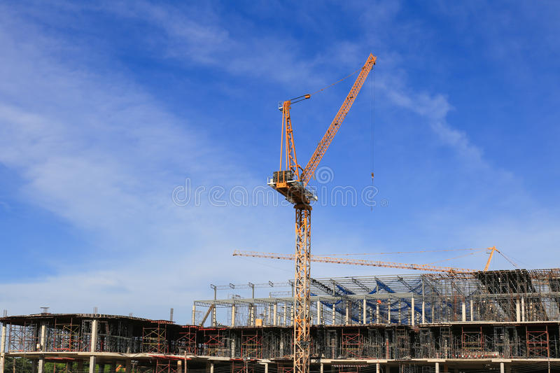 Building and crane, facility construction.  royalty free stock images