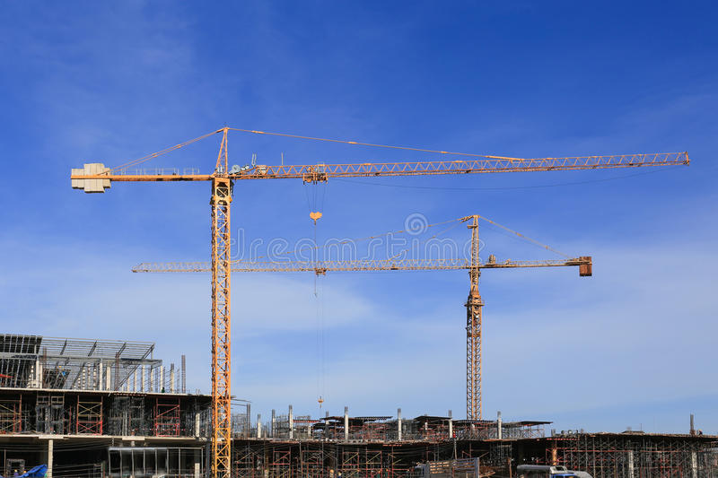 Building and crane, facility construction.  royalty free stock photos