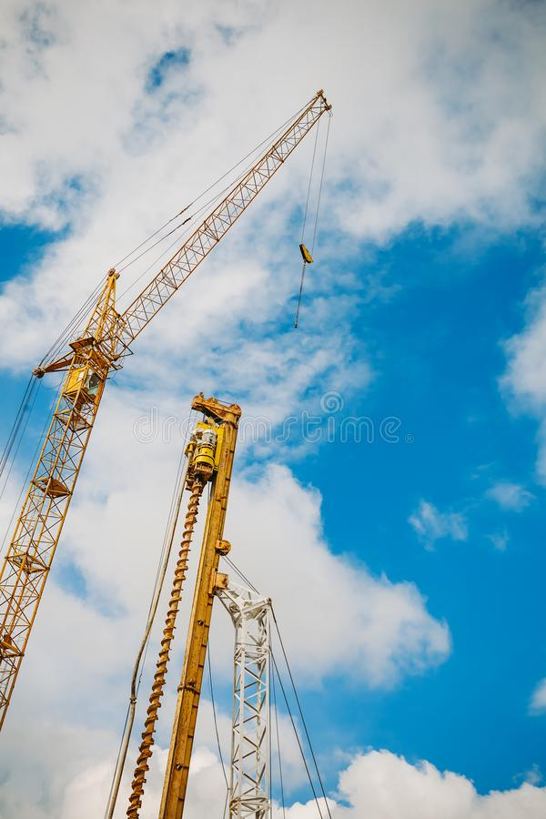 Building crane and building under construction against blue sky.  stock photography
