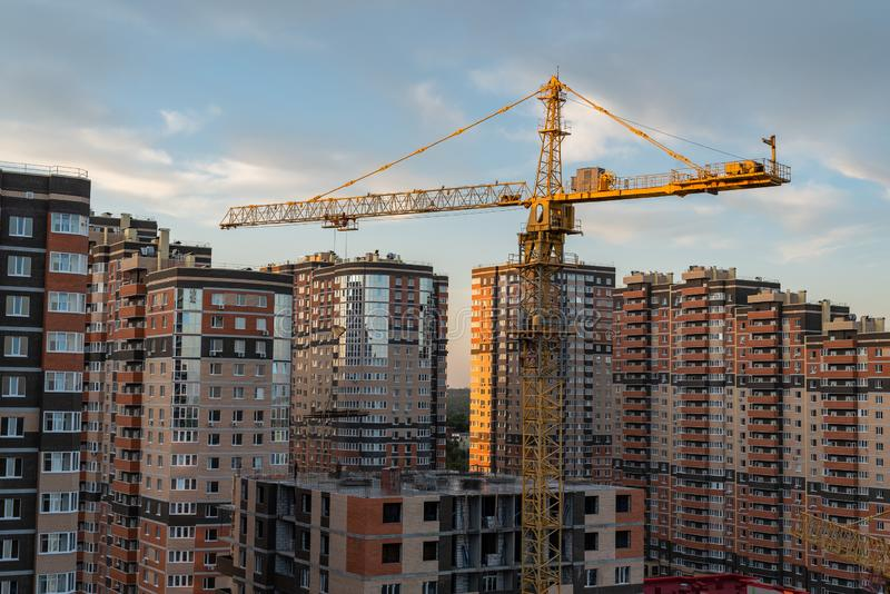Building crane and building under construction. Against blue sky stock photo