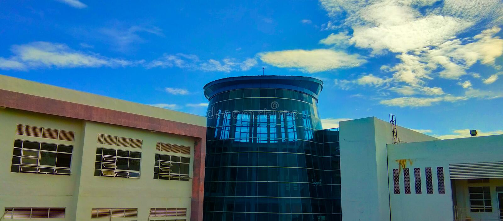 Building during the day under a blue sky.  what a beautiful day royalty free stock images