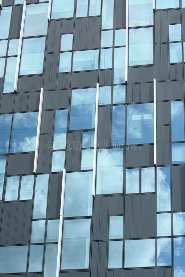 Building detail. Glass. reflection clouds. sky. A modern glass fronted building detail with reflection of clouds and sky royalty free stock photos
