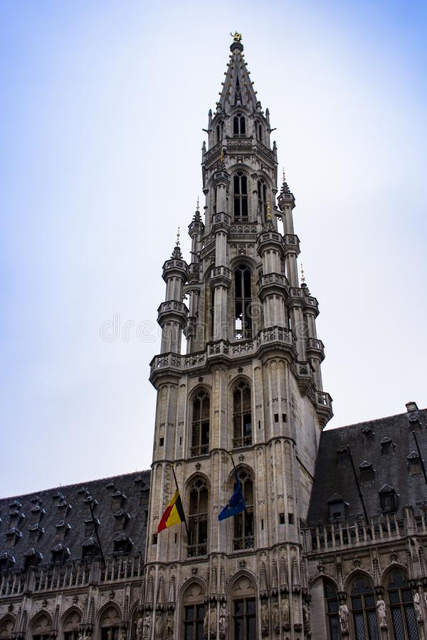 Building detail in Grand Place. Bustling Brussels Grand-Place centers on its namesake square, towered over by the Gothic City Hall and ringed by opulent guild stock image
