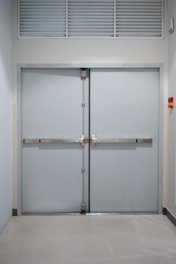 Building emergency exit door with fire alarm switch on wall & Building Emergency Exit Door With Fire Alarm Switch Stock Photo ...