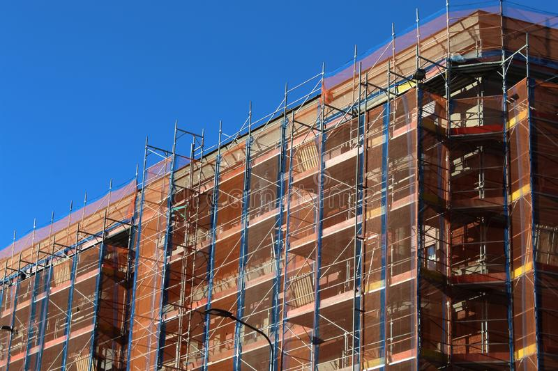 Building is encased in scaffolding royalty free stock photography