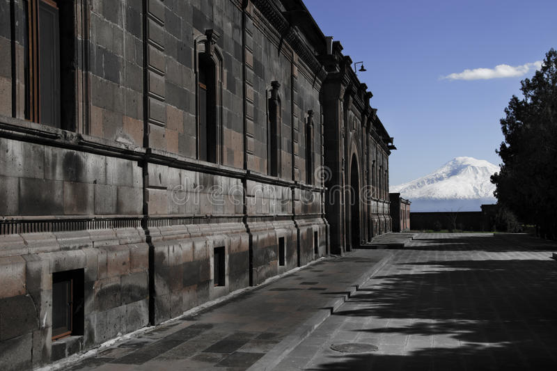 Building on Etchmiadzin Cathedral territory, background mountain Ararat, Masis, Armenia. Photo of the building on Etchmiadzin Cathedral territory, background royalty free stock photo