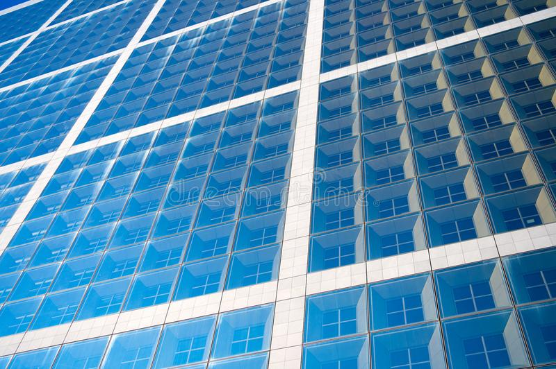 Building facade with blue glass windows. Modern architecture and structure. Construction and design. Commercial property. Or real estate. Perspective and future stock photography