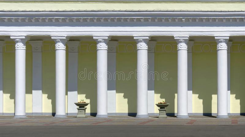 Building facade with columns. rhythm in architecture. decorative details in the Soviet style royalty free stock image
