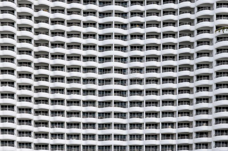 Building facade seamless, Rows of hotel many balcony with curved shape stock photography