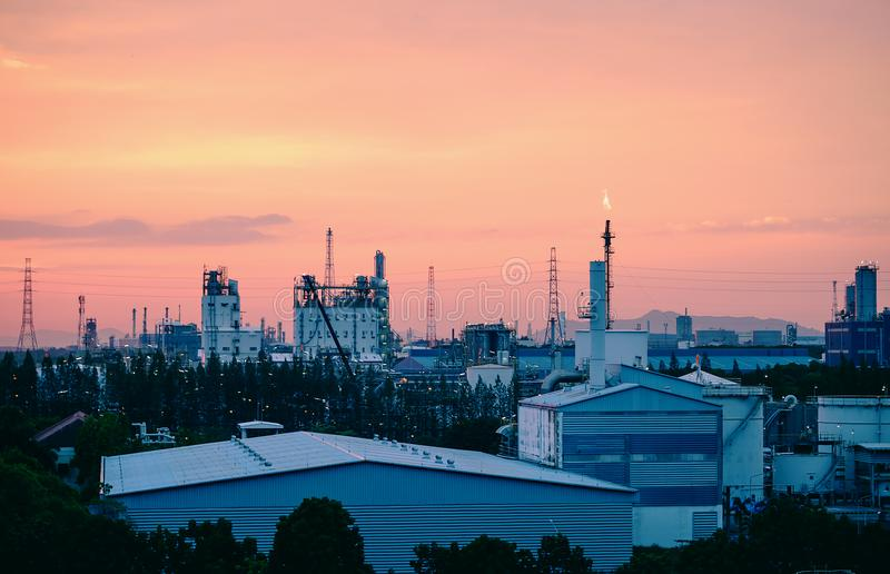 Factory. Building of factory with sunset sky, Industrial chemical plant stock photo