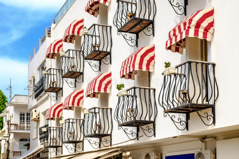 A building with figured balconies. royalty free stock photography