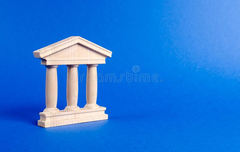 Building figurine with pillars in antique style. Concept of city administration, bank, university, court or library. Architectural stock photos
