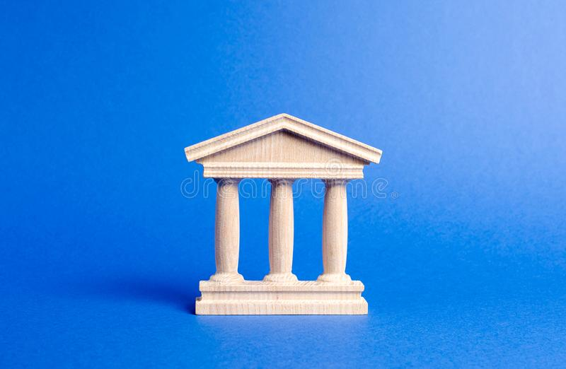 Building figurine with pillars in antique style. Concept of city administration, bank, university, court or library. Architectura. L monument in the old part of stock photography