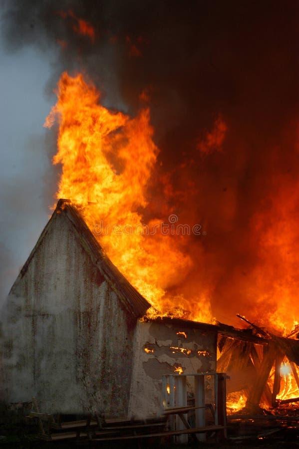 Building on fire stock photos