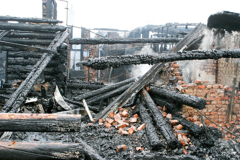 Building fire charred beams and roof stock photo