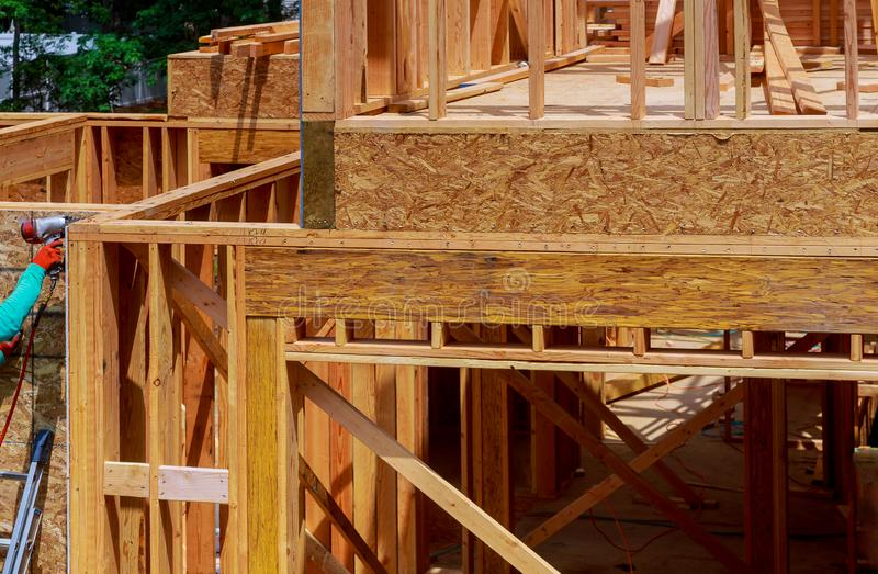 House timber frame for a progressing house a new development timber. Building frame structure on a new development timber frame for a progressing house royalty free stock image