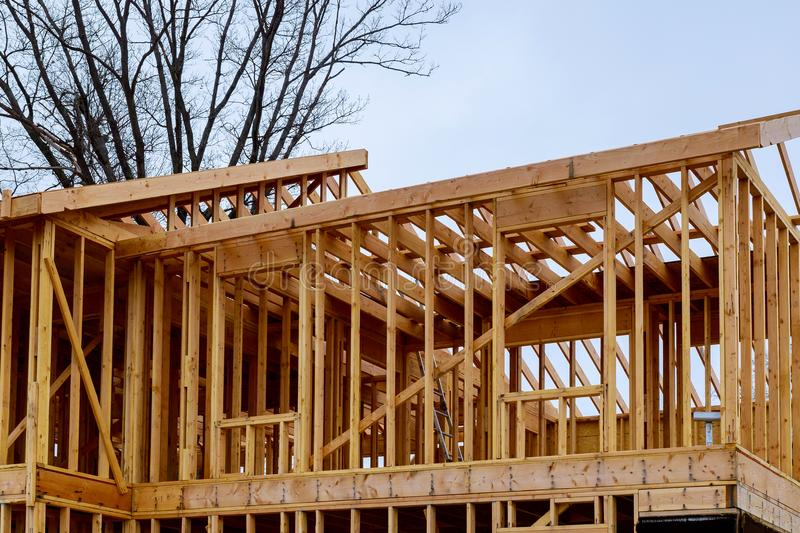 House timber frame for a progressing house. Building frame structure on a new development timber frame for a progressing house stock photo