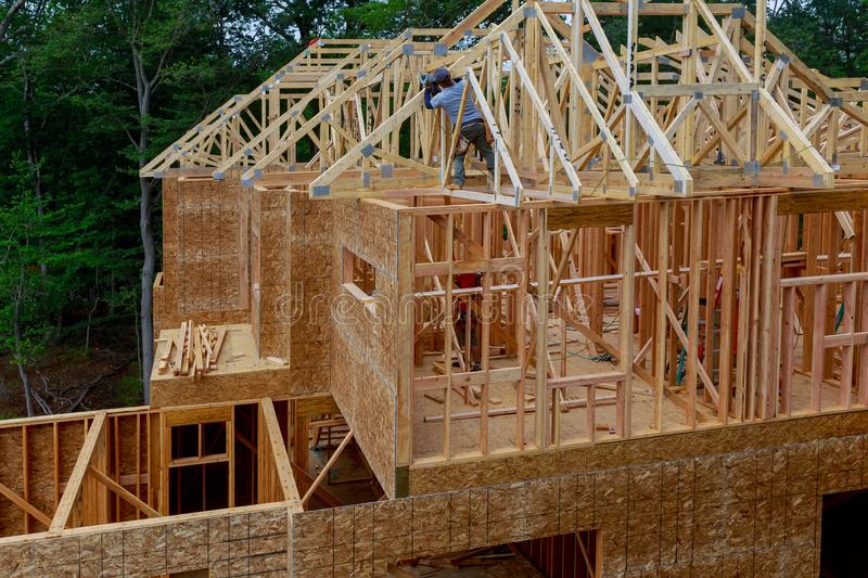 House timber frame for a progressing house a new development timber. Building frame structure on a new development timber frame for a progressing house roof stock image