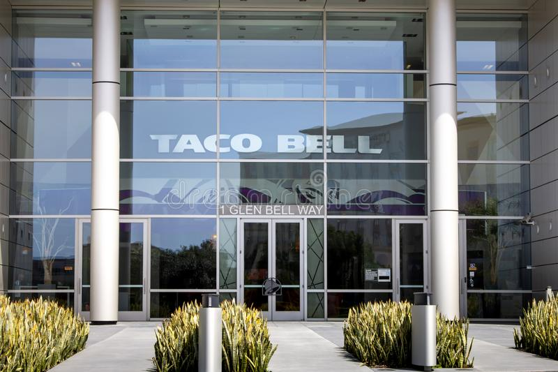 Taco Bell Headquarters building and sign. A building front sign for the Taco Bell headquarters, located in Irvine, California royalty free stock photo