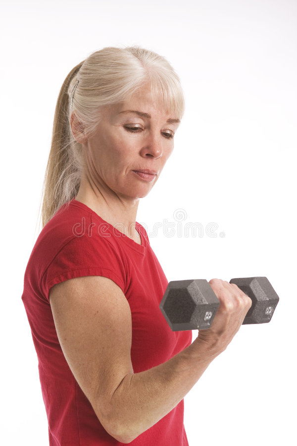 Building her arm muscles royalty free stock image