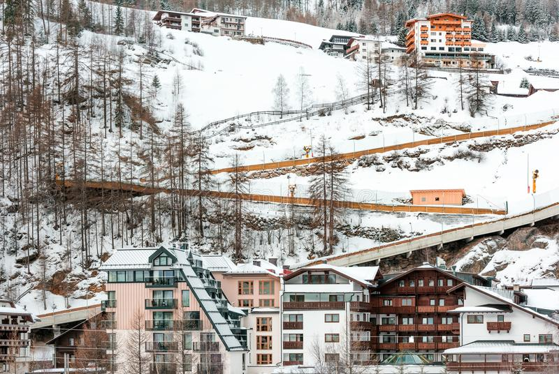 The building of hotels and chalets in the ski Alpine resort. Nature in winter and the mountainside stock images