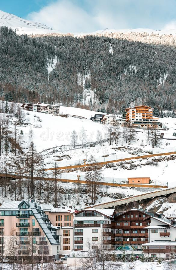 The building of hotels and chalets in the ski Alpine resort. Winter nature, mountain slope and blue sky royalty free stock images