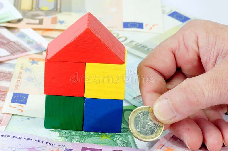 Building a house. Colorful toy brick house with Euro banknotes stock image
