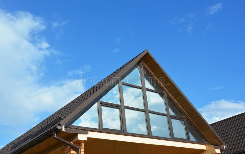 Building house attic conservatory terrace on the home roof. Conservatory or greenhouse roofing. Attic Exterior. Building house attic conservatory terrace on the royalty free stock photos