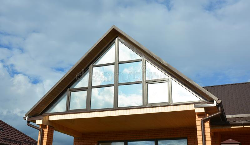 Building house attic conservatory terrace on the home roof with panoramic view. Conservatory or greenhouse roofing. Building house attic conservatory terrace on stock images