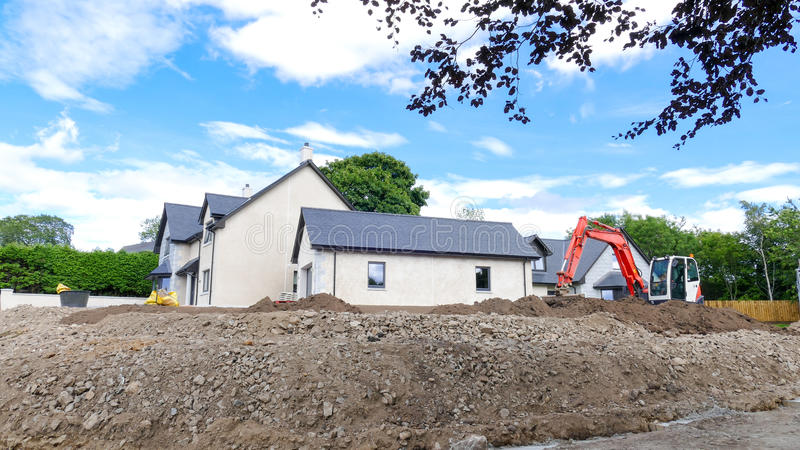 Building a house concept. Small digger in the background royalty free stock images