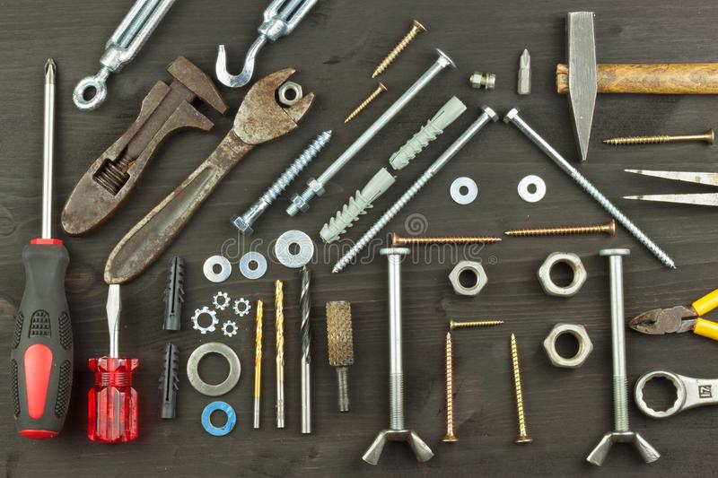 Building a house for the family. Needed for building. Building components. Screws and tools for building. royalty free stock photos