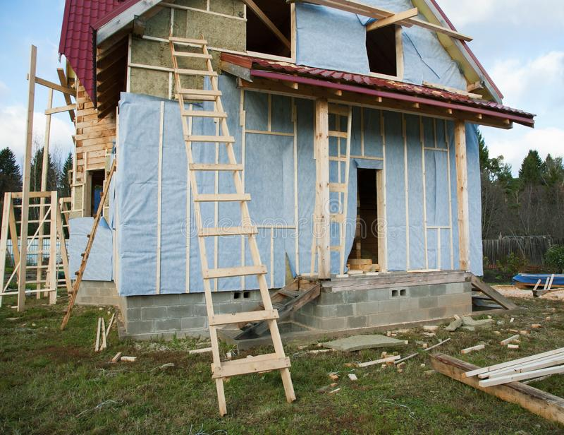 Building a house and a wooden staircase. Close-up stock photos