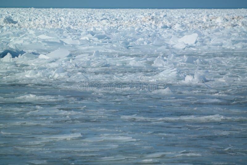 Ice shards accumulating on lake michigan stock photo