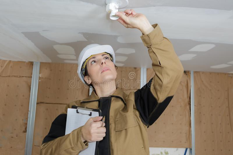 Building inspector inspecting outlet royalty free stock image