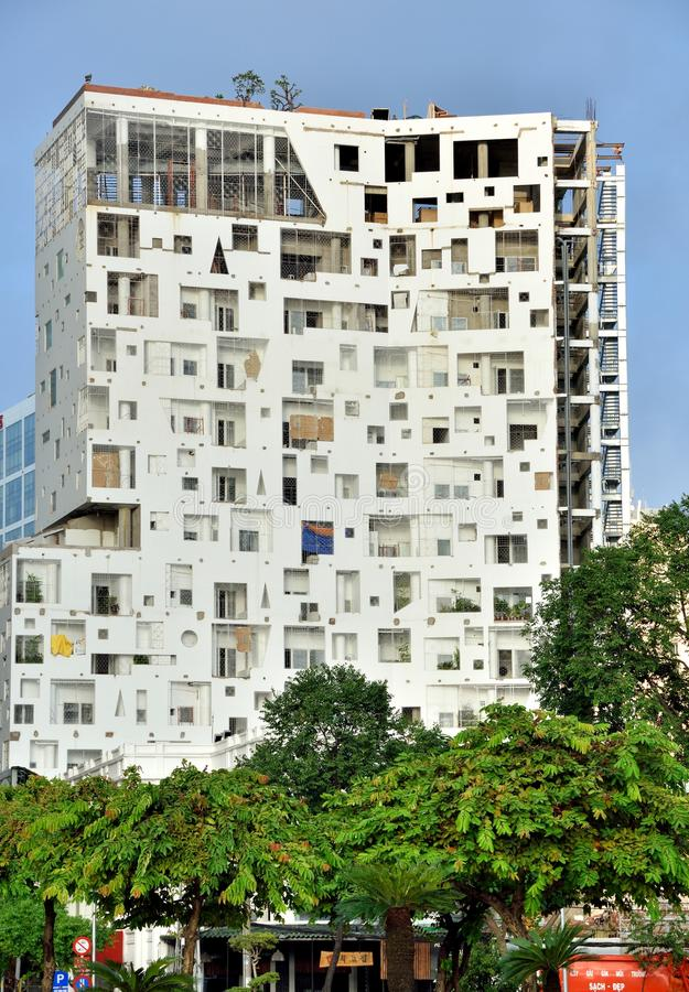 A building with interesting windows in Ho Chi Minh City, VietNam. Ho Chi Minh city view, a building with interesting windows stock images