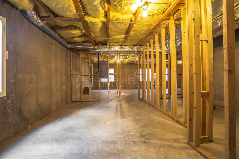 Building interior under construction with an electrical circuit breaker panel stock image