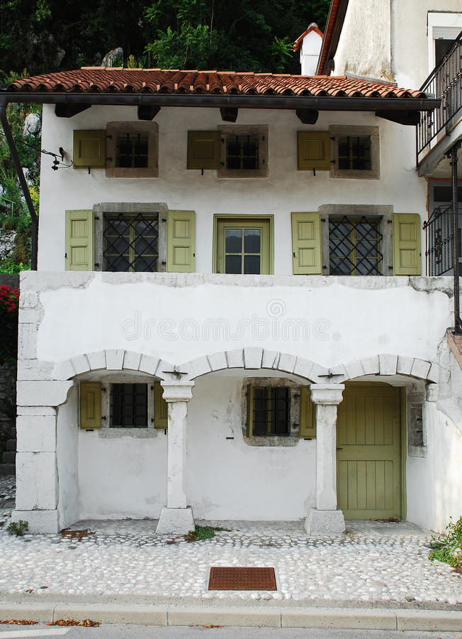 Building in Kobarid. An historic building in the north west Slovenian village of Kobarid in the Littoral region stock photography