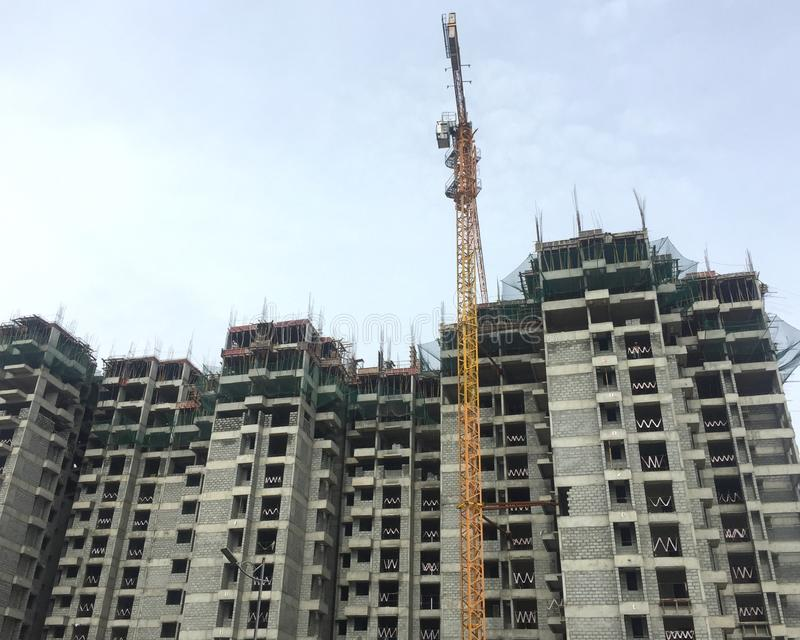 Building large apartments are a dangerous hazard for urban wildlife and city lakes. A building is getting constructed in Bangalore city where the urban wildlife stock images