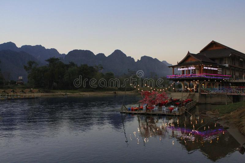 Building with lights on the river royalty free stock photography