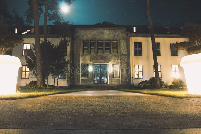 Building and lit courtyard at night stock photography
