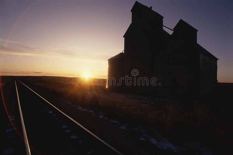 Building lit by sun. Buildings and railroad tracks lit by sun royalty free stock photos