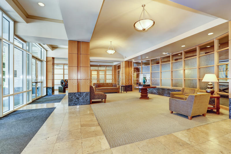 Building lobby with marble floor and furniture. Interior. Northwest, USA royalty free stock image