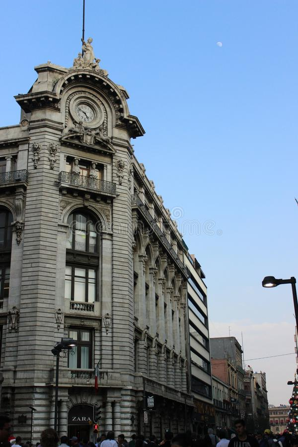 Building of Madero street with entrance around the corner, historical center of Mexico City. Spectacular building with corner facade of Madero street, historic stock photography