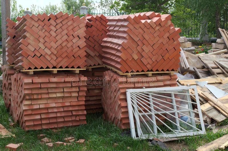 Building material: bricks, boards, frames. Building material: new red bricks, boards, frames lie on the ground stock photos