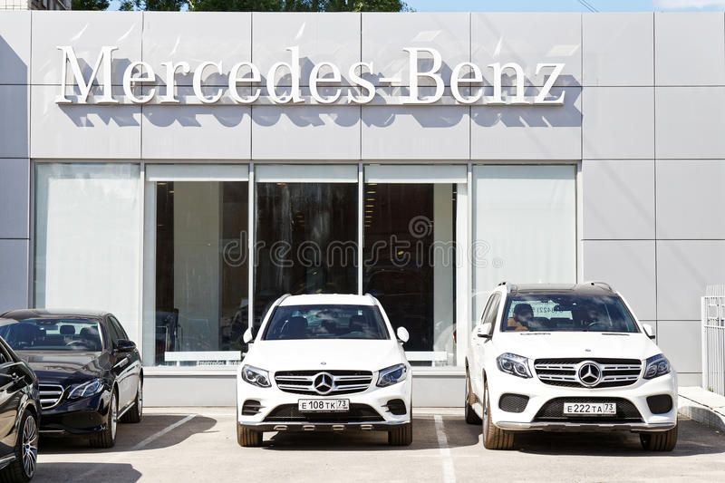 Building of mercedes benz car selling and service center for Mercedes benz sign in
