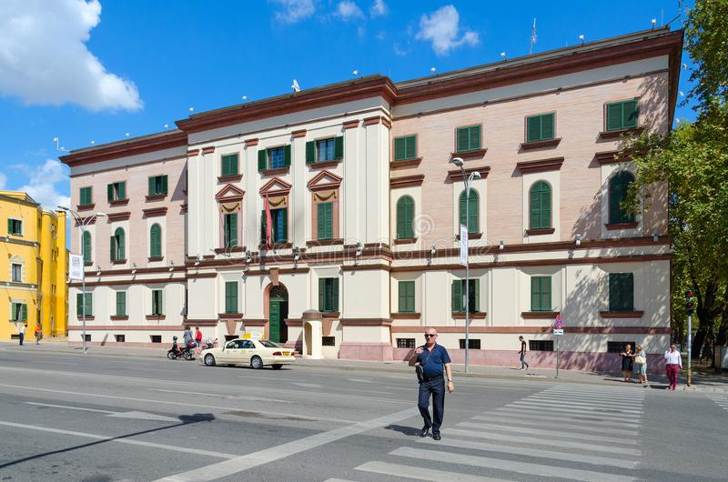Building of Ministry of Internal Affairs of Albania in Tirana. TIRANA, ALBANIA - SEPTEMBER 6, 2017: Unknown people walk along street near building of Ministry of stock photo