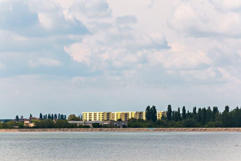Building near lake landscape stock photography
