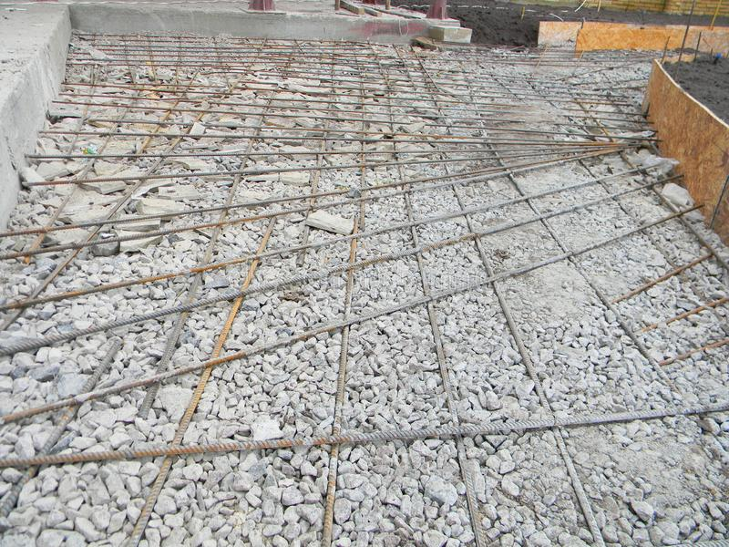 Building new concrete pavement foundation with iron bars. Building constraction patio. Building new concrete pavement foundation with iron bars. Building royalty free stock photography