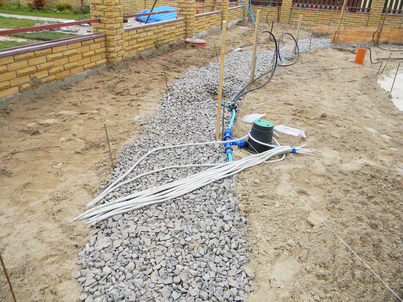 Building new concrete pavement for garden pathway. Foundation for paving with electrical wires and watering equipment garden royalty free stock photography